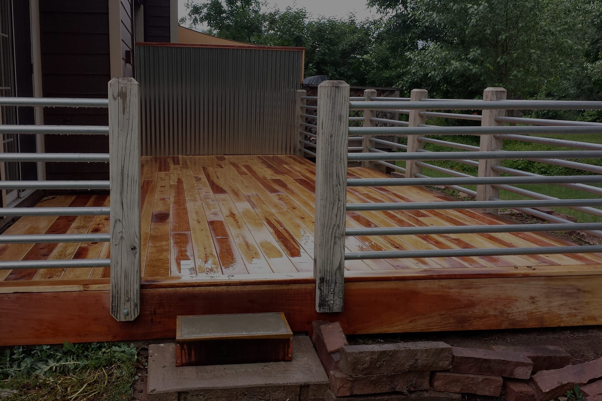 wood deck with metal railing
