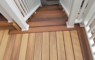 wood deck steps with white railing