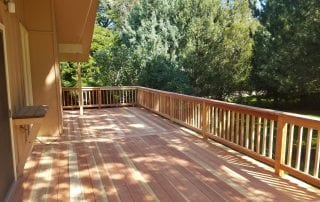 wood deck with wood railing