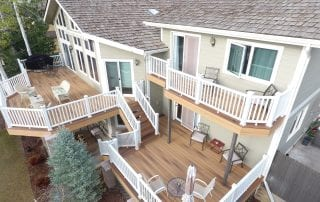 white house with multi-level deck