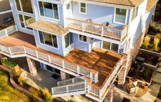 blue house with multi-level deck