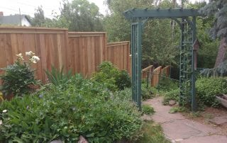 wood privacy fence with trellis