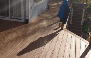 wood deck on blue house