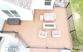 brown deck with black aluminum railing