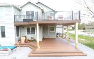 blue house with wood deck & patio