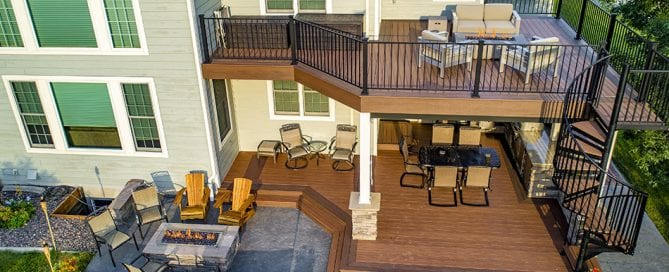 multi-level deck on tan house