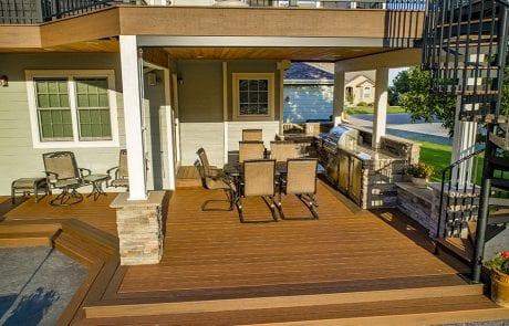 multi-level deck on tan house