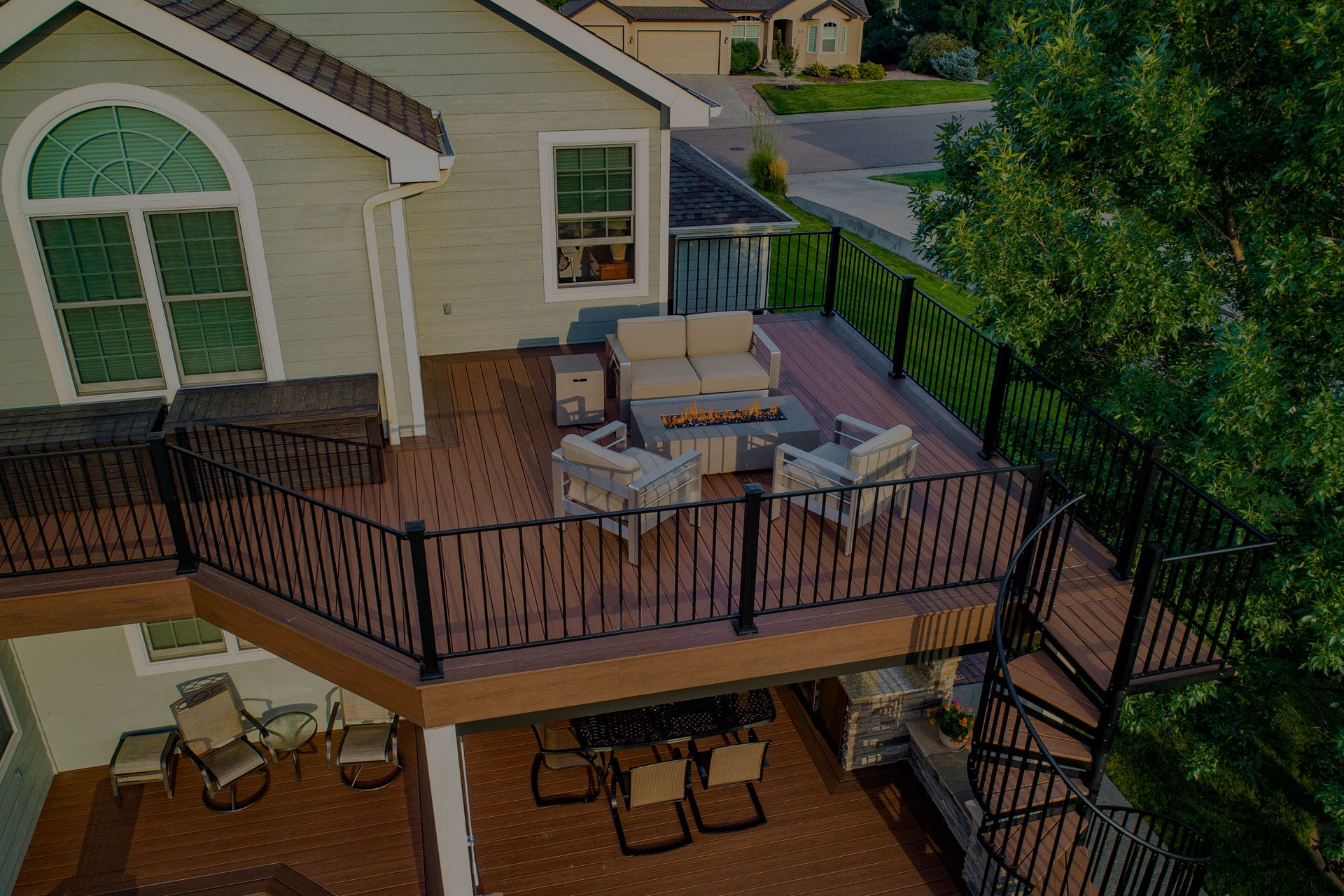 multi-level deck on yellow house